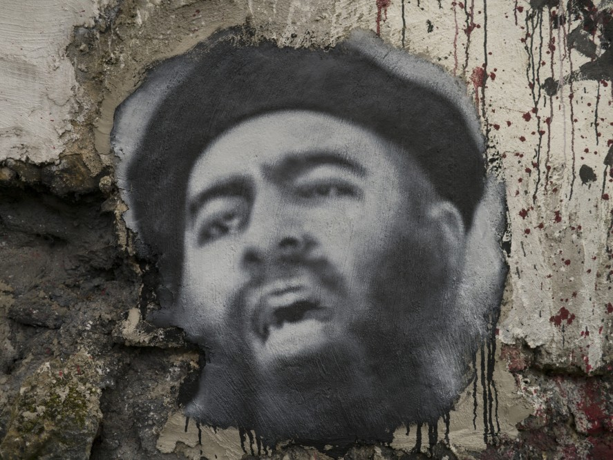 Painting on a wall of IS leader Abu Bakr al Baghdadi
