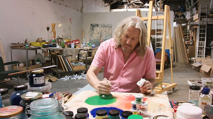 Wolfgang beltracchi mixes pigments in his studio. A still from the documentary The Art of Forgery.