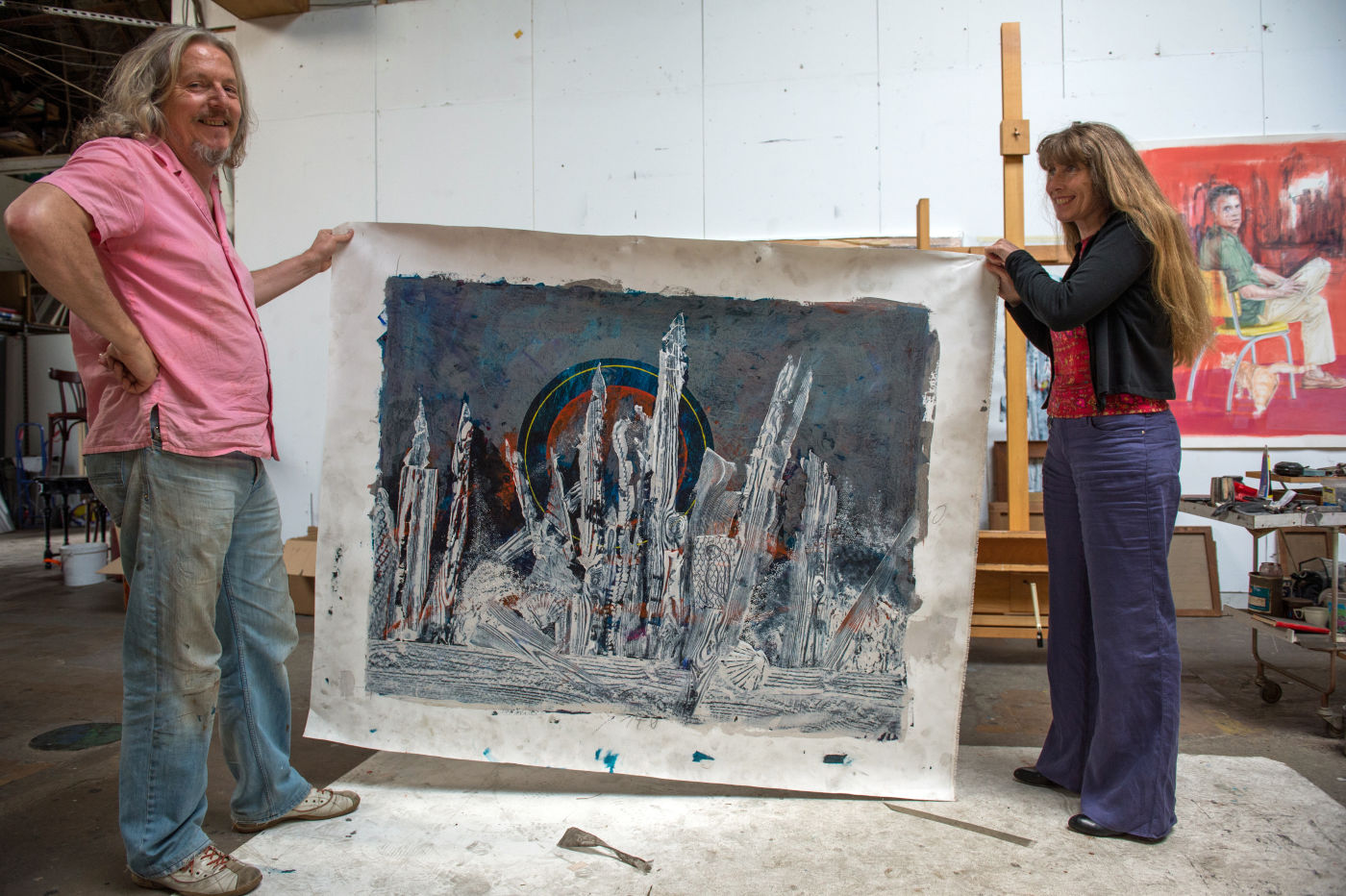 Beltracchi and his wife hold up the canvas of a Max Ernst forgery made while filming the documentary.