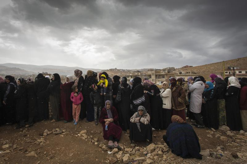 A long line of women wait to register with UNHCR in the town of Arsal, Lebanon in November 2013.